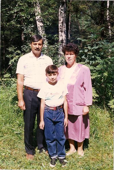Я с родителями в детстве.